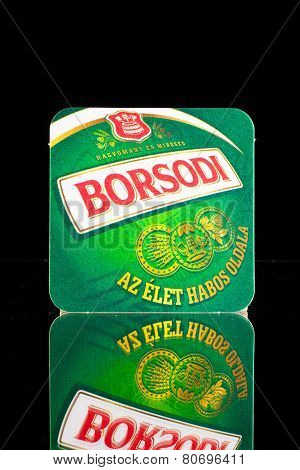 Beermat From Borsodi Beer On A Glass Table.