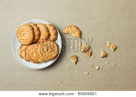 Biscuits On A Plate And Crumbs