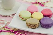 foto of dessert plate  - Vintage of Sweet french macaroons or macaron on white plate Dessert - JPG