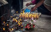 picture of pooja  - People lit up the oil lamps with flame near Hindu temple of Swayambhunath stupa in Kathmandu Nepal - JPG