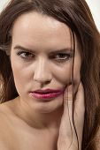 picture of sadomasochism  - sad young woman with smeared make up - JPG
