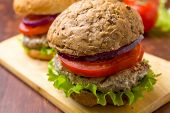 picture of whole-grain  - Healthy Chicken Hamburger with a Whole Grain Bun and Vegetables - JPG