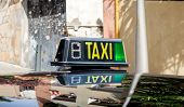 pic of cabs  - detail of a taxi cab in a Barcelona street - JPG