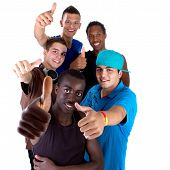 stock photo of teenage boys  - Young fresh interracial group of teenagers showing thumbs up sign as a sign of success - JPG