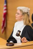image of court room  - Stern judge sitting and listening in the court room - JPG