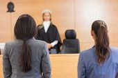 stock photo of court room  - Lawyers listening to the judge in the court room - JPG