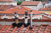 stock photo of air conditioning  - An image of old weathered chimney in italy - JPG