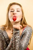 picture of hand kiss  - Closeup portrait of cute blonde woman blowing kiss from hand - JPG