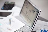 pic of chart  - Businessman analyzing investment charts with laptop. Accounting