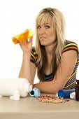 stock photo of yucky  - a woman holding on to a bottle with pills with a yucky expression - JPG