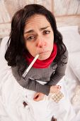 stock photo of thermometer  - Sick woman with thermometer - JPG