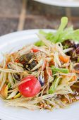 stock photo of green papaya salad  - Thai spicy papaya salad serve with vegetables - JPG