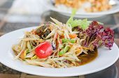 foto of green papaya salad  - Thai spicy papaya salad serve with vegetables - JPG