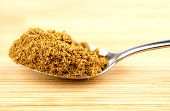 stock photo of cumin  - Macro closeup of crushed cumin seeds in spoonful - JPG