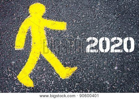 Yellow Pedestrian Figure Walking Towards Year 2020