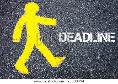 Yellow Pedestrian Figure Walking Towards Deadline