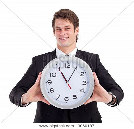 handsome businessman holding clock