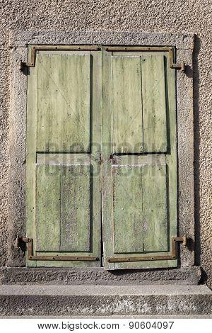 Rustic Green Wooden Doors Hanging Askew On Hinges