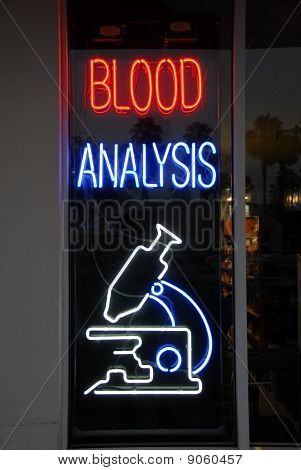 Blood analysis neon sign isolated on a window panel