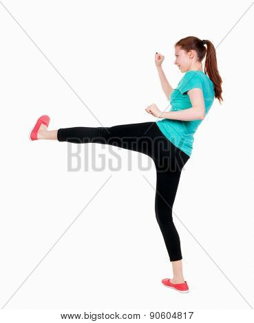 skinny woman funny fights waving his arms and legs. Rear view people collection.  backside view of person.  Isolated over white background. Girl in sportswear with a smile beats foot.
