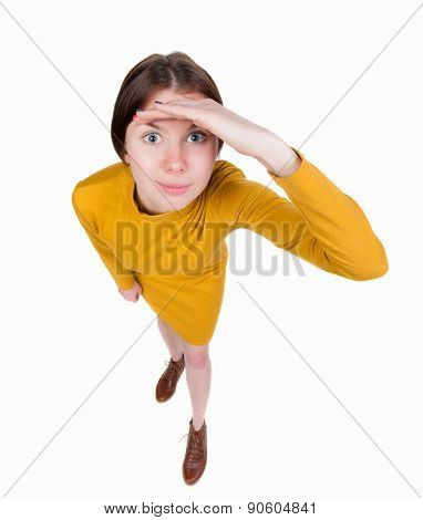 Portrait of a woman peep. funny picture. Wide-angle. Isolated over white background. The girl in a brown dress is watching you.