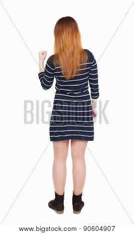 Back view of  joyful woman celebrating victory hands up. Rear view people collection. backside view of person. Isolated over white background. Girl in a striped dress with a hand fist.