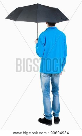 Back view of man in jeans under an umbrella. Standing young guy. Rear view people collection.  backside view of person.  Isolated over white background. Curly boy in the rain.