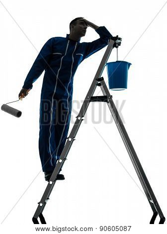 one  man house painter worker silhouette in studio on white background