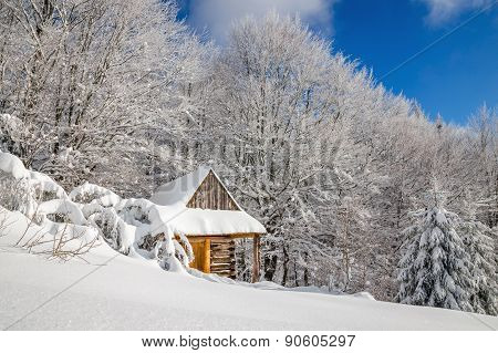 Quiet wooden mountain cabin in winter