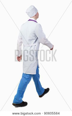 Back view walking doctor in a robe hurrying to help the patient. Walking guy in motion. Rear view people collection. Backside view of person. Isolated over white background. nurse rushes for surgery