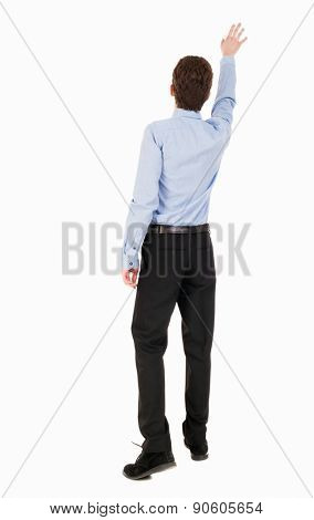 Back view of pointing business man. gesticulating young guy in black suit. Rear view people collection.  backside view person. Isolated over white background. Businessman accompanies departing plane
