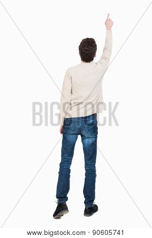 Back view of pointing business man. gesticulating young guy in black suit. Rear view people collection.  backside view of person.  The man saw something high up.