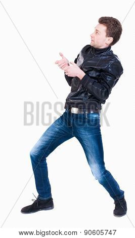 back view standing man pulling a rope from the top or cling to something.  Rear view people collection. backside view of person.  Isolated over white background. curly-haired man pulls rope fictional