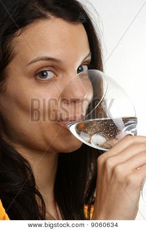 A Young Woman Drinks Water From A Glass