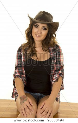 Cowgirl With Rose Tattoo On Hand Sit And Look
