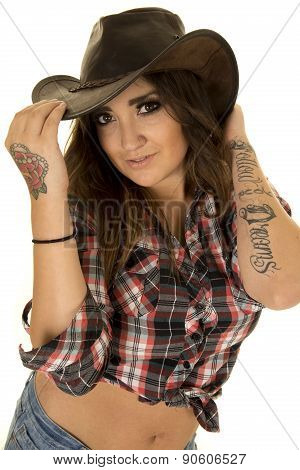 Cowgirl With Tattoo And Hat High View Close