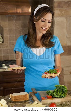 Attractive Woman Or American Mom Making Sandwiches In Home Kitchen