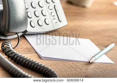 Pen Lying On Blank White Note Cards Next To A Landline Telephone