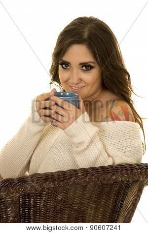 Woman In White Sweater And Tattoo Sit Blue Mug Sip