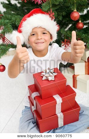 Happy Boy With Lots Of Christmas Presents