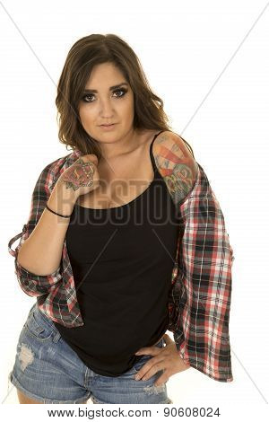 Woman With Tattoo In Plaid Shirt Show Shoulder