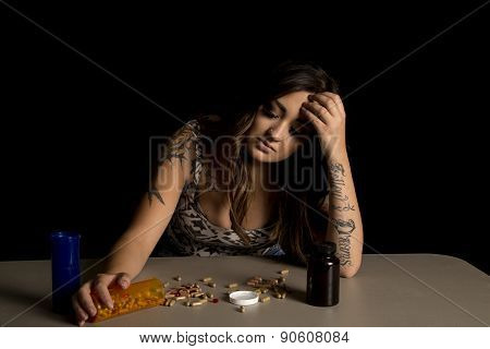 Woman With Tattoo With Drugs Addicted