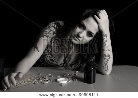 Woman With Tattoo With Drugs Head Tilted