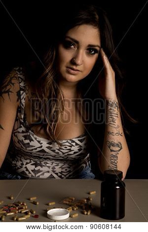 Woman With Tattoo With Drugs Look Serious