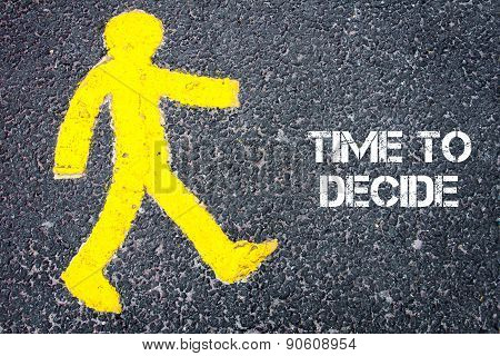 Yellow Pedestrian Figure Walking Towards Time To Decide