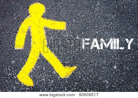 Yellow Pedestrian Figure Walking Towards Familiy