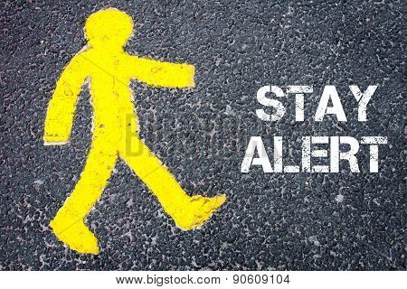 Yellow Pedestrian Figure Walking Towards Stay Alert