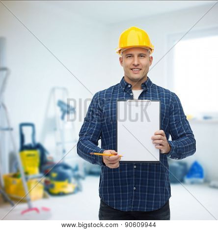 repair, construction, building, people and maintenance concept - smiling male builder or manual worker in helmet with clipboard over room with work equipment background