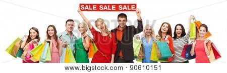 consumerism, people and discount concept - group of happy people with sale sign and shopping bags
