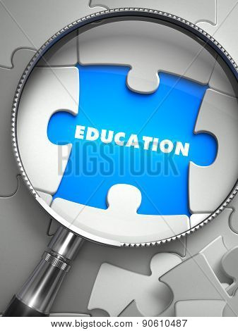 Education - Puzzle with Missing Piece through Loupe.